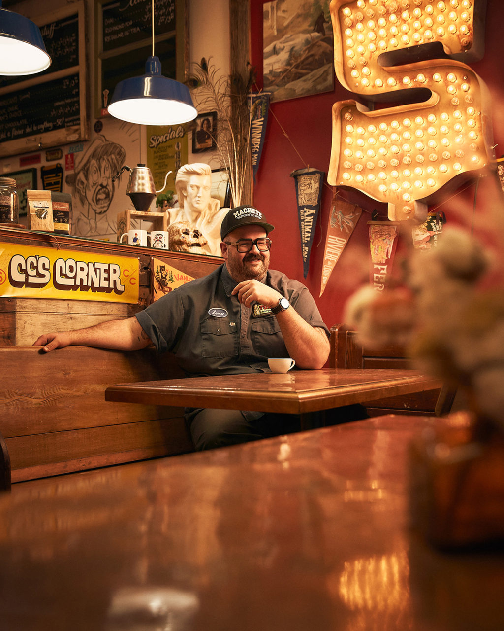 This is a magazine cover shot by Ottawa  Editorial  photographer Matthew Liteplo for a local food magazine Edible Ottawa. This editorial portrait was taken in Richmond Ontario a close town to Ottawa and Perth. The concept behind the portrait is to capture the oddities and interesting pieces of brick a brack that are hanging in the cafe.  As an editorial photographer, matthew liteplo works to create interesting character portraits. With limited content usage, is can be used for online editions as well as social media.